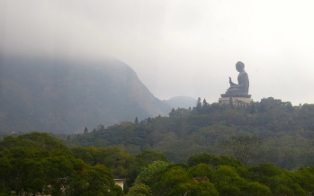 A blanket of fog enveloping the tip of Lantau Peak, as the view of the Tian Tian Buddha beckons