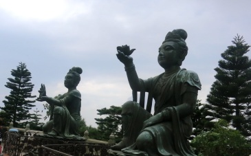 """2 out of 6 statues that comprise """"The Offering of the Six Devas"""", a representation of devotees presenting offerings to the Tian Tian Buddah"""